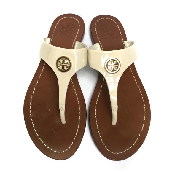d98f8437bea Tory Burch Cameron Ivory Patent Thong Sandals. M 5b38445dd6dc52ab8e39de42